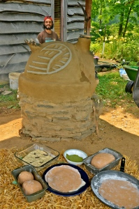 Author and his cob oven, built with art to represent a wild turkey, common on the land there